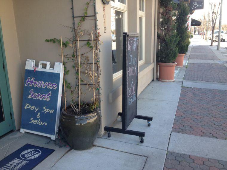 City officials weigh downtown sign enforcement