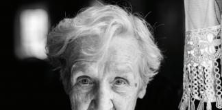 senior woman facing camera b/w photo
